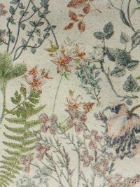 Lahjapaperi ruohopaperista, jossa kuvioaiheena luonnon kukkia.