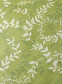 Lahjapaperi ruohopaperista, kuvioaiheena valkoinen köynnös vihreällä pohjalla.